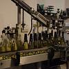 Final stage of corking the champagne bottles after removing sediments and refilling the missing amount.